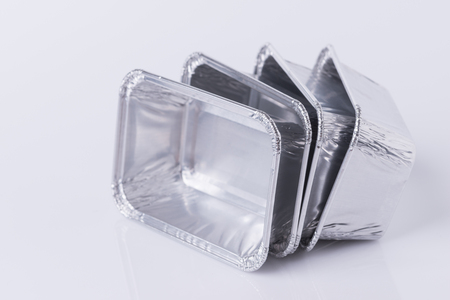 Foto de Aluminum foil tray on white background - Imagen libre de derechos