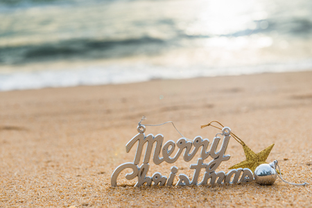 Photo pour Christmas ball and decorations on the sand of tropical ocean beach , happy New Year and Merry Christmas holidays travel destinations concept - image libre de droit
