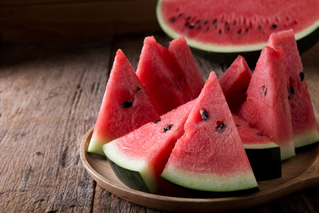 Foto de Red Watermelon on wooden table background - Imagen libre de derechos