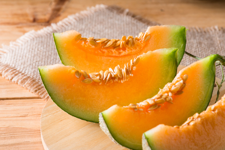 Photo for Melon slice on wooden table background - Royalty Free Image