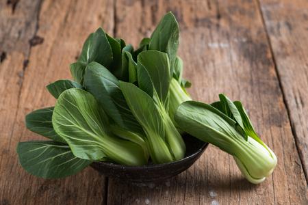 Photo pour Pak Choy, fresh chinese cabbage  on wooden background - image libre de droit