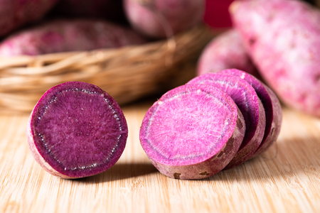 Photo for Sweet Potatoes Purple Colored on Wood Table background - Royalty Free Image