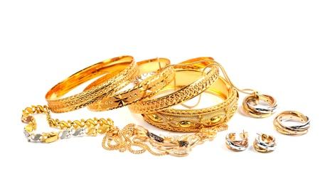 Photo pour Golden bracelets and necklece with diamonds, over white - image libre de droit