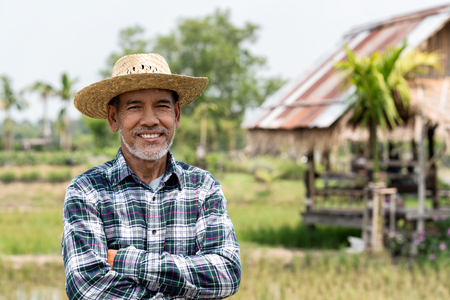 Photo pour Portrait happy mature man is smiling. Senior farmer with white beard feeling confident. Elderly asian man standing ,cressed his arm and in a shirt and looking at camera. - image libre de droit