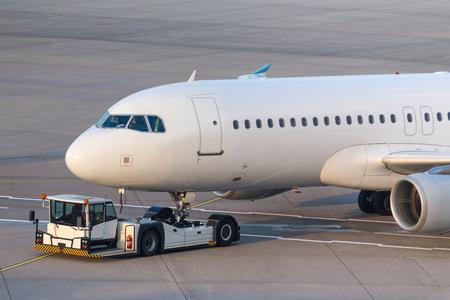 Foto de passenger airplane beeing towed at an airport - Imagen libre de derechos