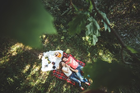Photo pour Photo beautiful couple under a tree on a background of grass - image libre de droit