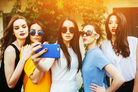 Photo for five beautiful young girls make selfie on the street near house - Royalty Free Image