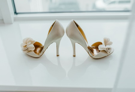 Foto de White pair of shoes on the table. - Imagen libre de derechos