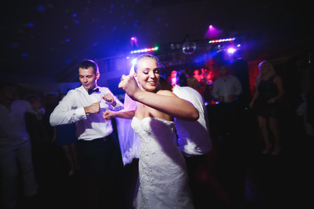 Foto für beautiful bride and groom dancing among the people on the dance floor - Lizenzfreies Bild