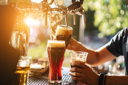 Photo for bartender pours a dark beer close up - Royalty Free Image