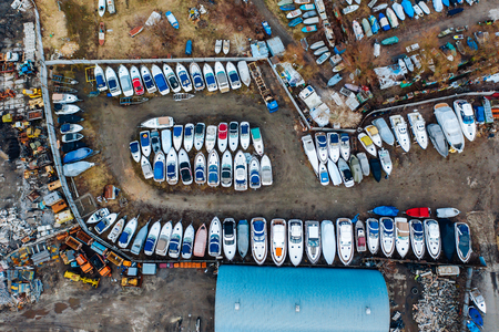 Foto per Aerial view of boat yard on land. Stored ships during winter time - Immagine Royalty Free