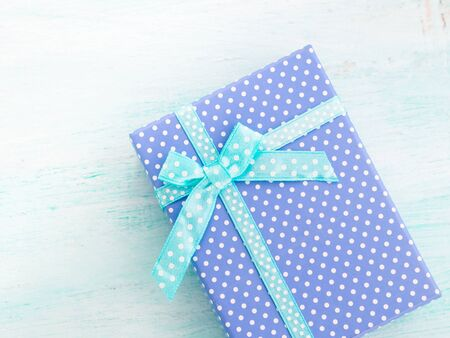 Photo for Blue gift box with ribbon on pastel background. Copy space top view fathers day Christmas special occasion present - Royalty Free Image