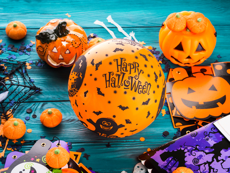 Photo for Halloween decoration symbols on dark rustic wooden background. Wishing happy holiday with orange balloon - Royalty Free Image
