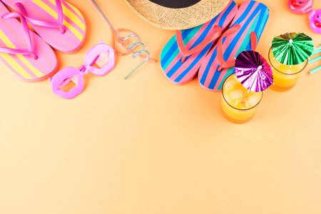 Photo for Vacation on the beach concept with colorful summer cocktails and beach accessories - hat, flip flops, sun glasses - Royalty Free Image