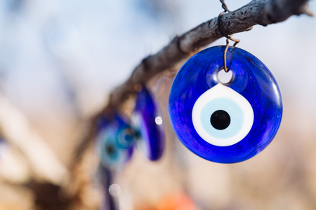 Photo for Nazar, charms to ward off the evil eye , on the branches of a tree in Cappadocia, Turkey - Royalty Free Image