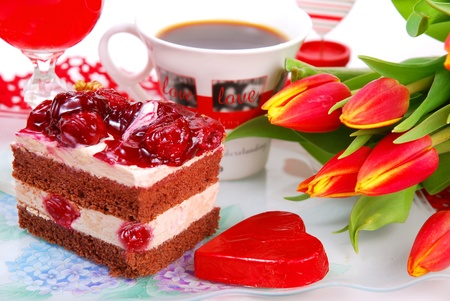 Foto de cherry cake,coffee,and tulips for Valentine`s party - Imagen libre de derechos
