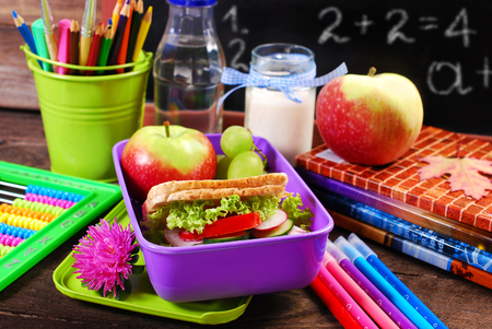 Photo for healthy breakfast for school  with sandwich ,fresh fruits and drink in lunch box - Royalty Free Image