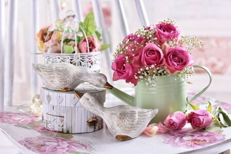 Photo pour romantic style still life with bunch of pink roses and decors in pastel colors - image libre de droit
