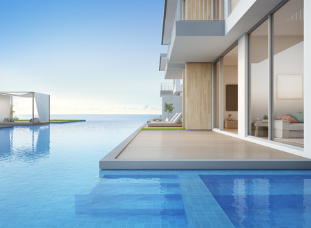 Photo for Luxury beach house with sea view swimming pool and empty terrace in modern design, Lounge chairs on wooden floor deck at vacation home or hotel - 3d illustration of contemporary holiday villa exterior - Royalty Free Image