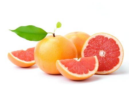 Photo for Ripe grapefruit with leaves and slices on white background - Royalty Free Image