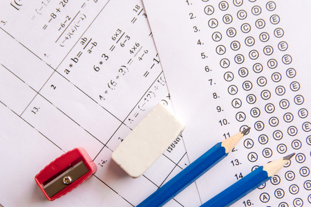 Foto de Pencil, Sharpener and eraser on answer sheets or Standardized test form with answers bubbled. multiple choice answer sheet - Imagen libre de derechos