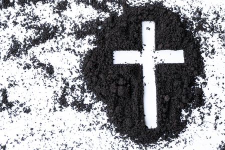 Photo for Cross or crucifix made of ash, dust or sand. Ash Wednesday. Lent. Christian religion. - Royalty Free Image