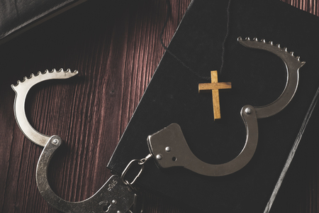 Photo for Simple Wood Cross and Unchain Handcuffs. Concept of Jesus Christ the Savior Liberate People from Sin. - Royalty Free Image