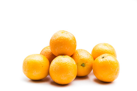 Foto de Stack of fresh and juicy naval oranges isolated in white - Imagen libre de derechos