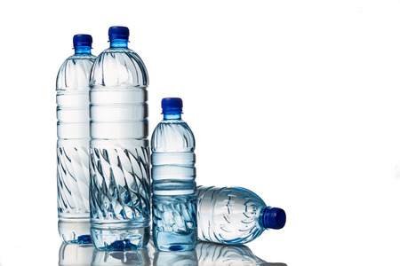 Photo pour Four refreshing natural mineral water in plastic bottle in white background - image libre de droit