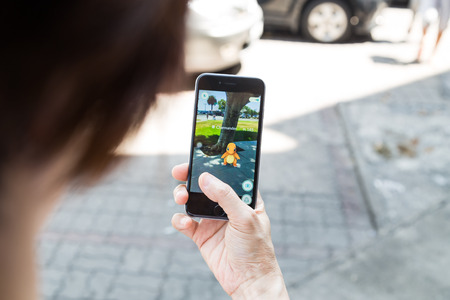 Photo pour KUALA LUMPUR, MALAYSIA, JULY 16, 2016: An IOS user plays Pokemon Go, a free-to-play augmented reality mobile game developed by Niantic for iOS and Android devices. - image libre de droit