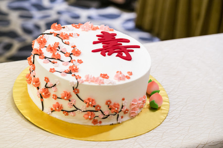 Photo for Decorated birthday cake celebration for eldery person with Chinese word Longevity - Royalty Free Image