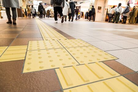 Photo pour Indoor tactile paving foot path for the blind and vision impaired handicap in Japan - image libre de droit