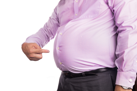 Photo pour Man in shirt pointing own unhealthy big belly with visceral or subcutaneous fats. Pose health risk. - image libre de droit