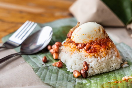 Foto de Simple authentic nasi lemak wrapped in banana leaf, popular breakfast in Malaysia - Imagen libre de derechos