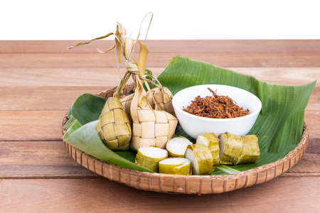 Photo for Ketupat, lemang, served with serunding, popular Malay delicacies during Hari Raya celebration in Malaysia - Royalty Free Image