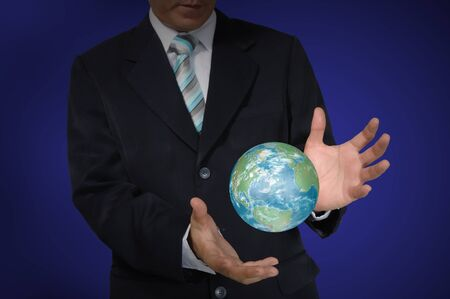 Business Man holding earth globe