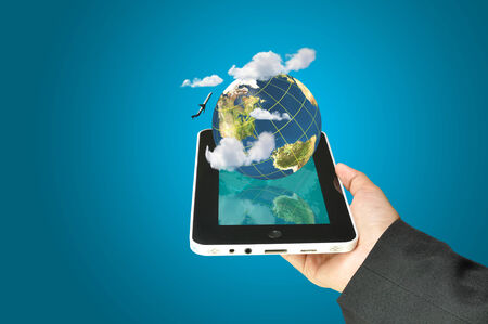 female hand holding a tablet touch computer gadget present earth globe and airplane as transportation concept.