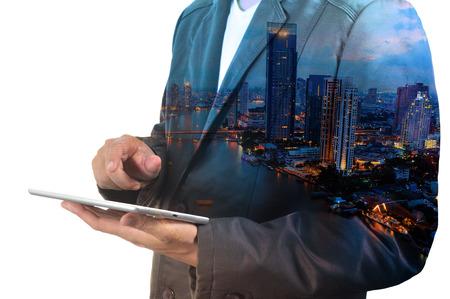 Photo pour Double exposure of city and Businessman use Tablet device as Business development concept. - image libre de droit