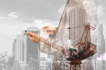 Foto de Double exposure of Business Man and Power Crane in the City as Construcition Project concept. - Imagen libre de derechos