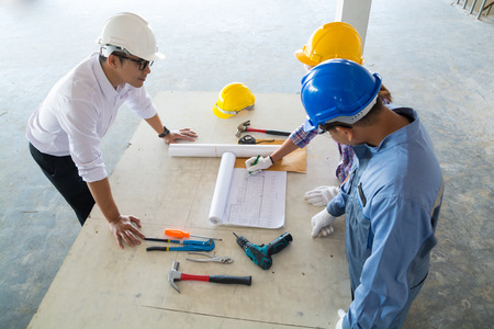 Photo for Construction team, Architect, Engineer and Foreman discussing in Building Construction site as Real Estate Project Development Concept - Royalty Free Image