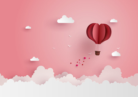 Photo pour illustration of love and valentine day,Origami made hot air balloon flying on the sky with heart float on the sky.paper art style. - image libre de droit