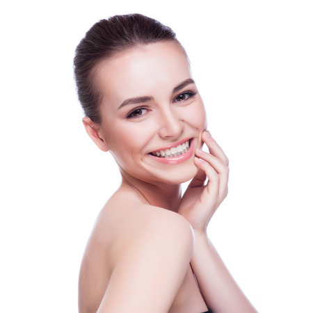 Foto de Beautiful face of young adult woman with clean fresh skin - isolated on white - Imagen libre de derechos