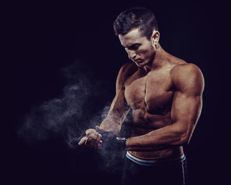 MMA Fighter Preparing Bandages For Training. Darck background