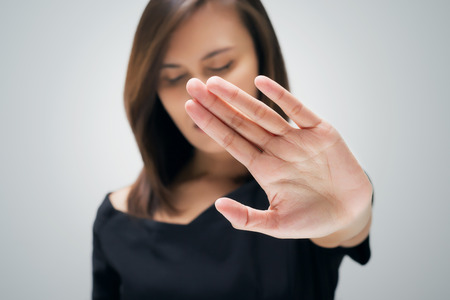 Photo for Young woman showing her denial with NO on her hand - Royalty Free Image
