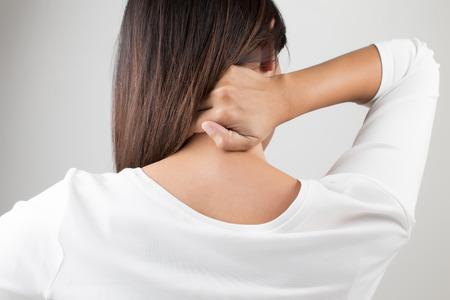 Foto de Young woman having pain in the back and neck,Pain in the back - Imagen libre de derechos