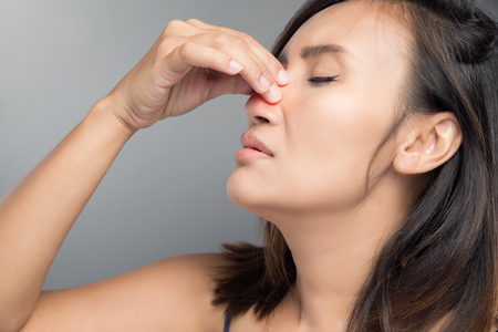 Photo pour The asian woman hurts her nose because she has cold. - image libre de droit