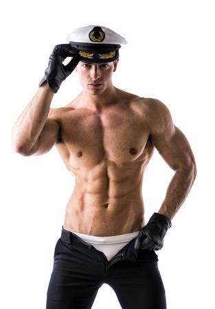 Foto de Muscular shirtless male sailor with nautical hat, isolated on white - Imagen libre de derechos
