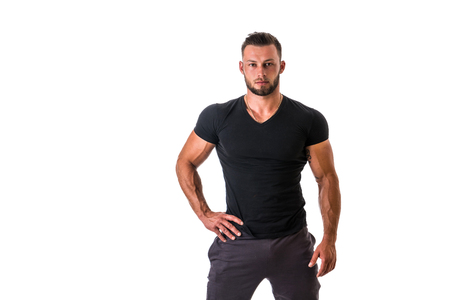 Photo pour Handsome muscular man standing, isolated on white background in studio shot - image libre de droit