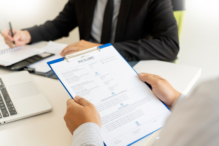 Photo for Job Interview and hiring concept, Appointment candidate Business man explaining about his profile and answer to Human resources manager sitting at a table opposite in the office - Royalty Free Image