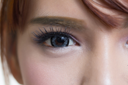 Photo for Close-up shot of asian woman eye with contact lens gray colour - Royalty Free Image